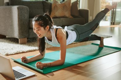 Smiling woman exercising at home